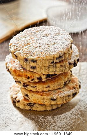 Welsh cake with currants and icing sugar