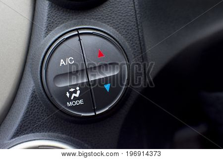 Controller button of air conditioner in car interior for temperature climate adjustment. selective focus. Automotive part concept.