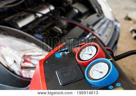 Refilling of car air conditioner in auto repair shop