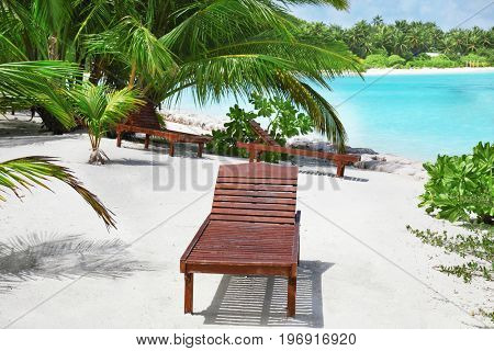 Sun lounger on beach at tropical resort