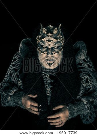 Demon With Scarf On Head Isolated On Black
