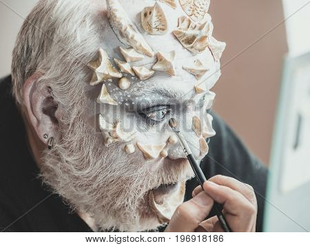 Actor Applying Make Up On Face