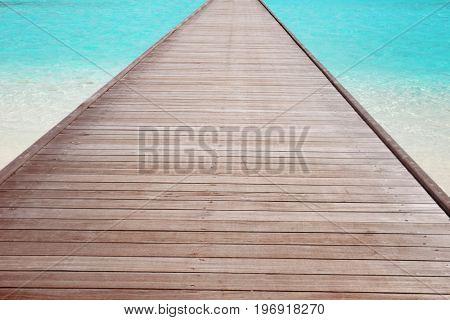 Wooden pontoon at sea resort in summer day