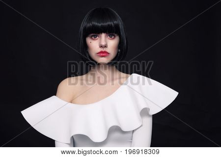 Young beautiful woman with stylish bob haircut and cosplay contact lenses