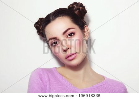 Young beautiful girl with fancy hairdo in casual outfit