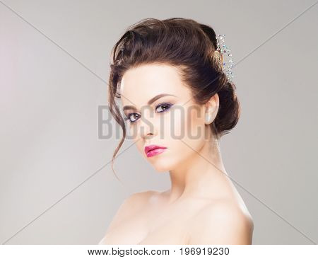 Portrait of gorgeous brunette wearing luxury headband over isolated background.