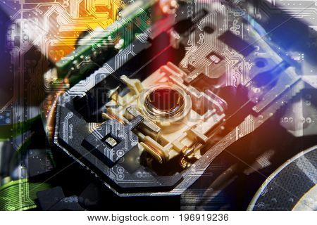 Close up macro Laser Head reader of cd player system equipment installed on electronics circuit board Double Exposure Circuit board pattern illustration design Electronics equipment concept.