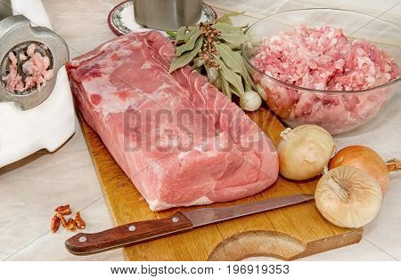 Meat tenderloin for cooking meat through a meat grinder with onions and Bay leaf. The horizontal frame.