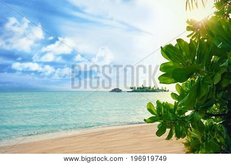 View of beautiful tropical beach at sea resort. Summer vacation concept