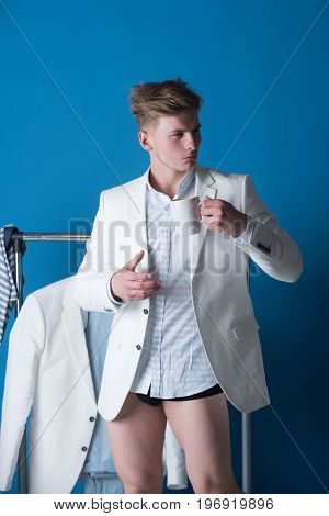 Macho In Shirt, Jacket And Underpants Drinking From Cup