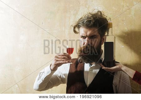 Man Holding Glass With Wine And Bottle On Female Hand