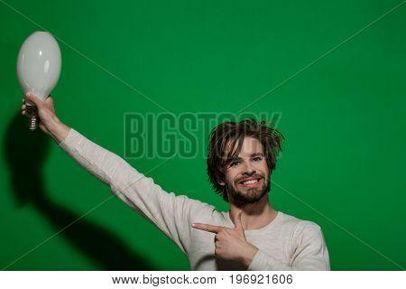 Man Smiling With Big Lamp
