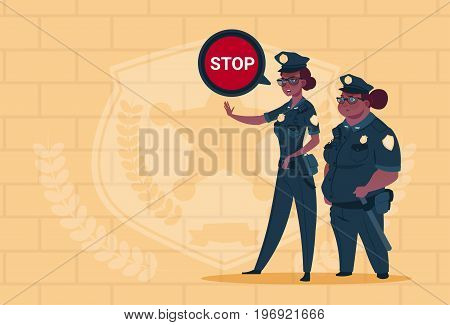 Two African American Police Women Holding Stop Sign Wearing Uniform Female Guards On Blue Bricks Background Flat Vector Illustration