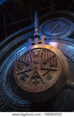 LEAVESDEN UK - JUNE 19TH 2017: The swinging clock tower pendulum prop on display at the Making of Harry Potter Studio Tour at the Warner Bros. Studios in Leavesden UK on 19th June 2017.