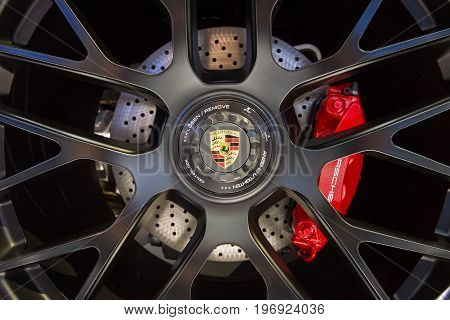 BERLIN - MAY 02 2015: Showroom. Wheels and braking system of a sports car Porsche 911 Targa 4 GTS. Produced since 2014.