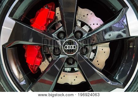 BERLIN - MAY 02 2015: Showroom. Wheels and braking system components of a hot hatch Audi RS3 (8VA). Produced since 2015.