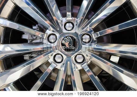 BERLIN - MAY 02 2015: Showroom. Wheels and braking system of a large family car Skoda Superb (Third generation). Produced since 2015.