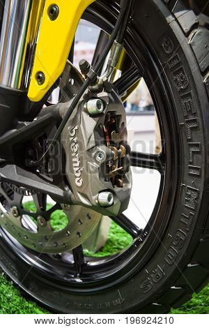 BERLIN - MAY 02 2015: Showroom. Detail of the front wheel and brake system of motorcycle Ducati Scrambler Classic. Produced since 2015.