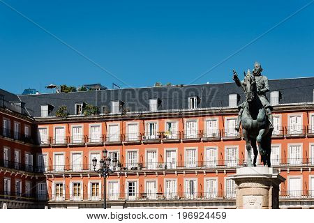 Madrid Spain - July 2 2017: Statue of Philip III in Plaza Mayor in Madrid. It was built during Philip III's reign and is a central plaza in the city of Madrid. Sunny summer day.