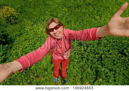 Top view photo of cheerful smiling woman on green grass