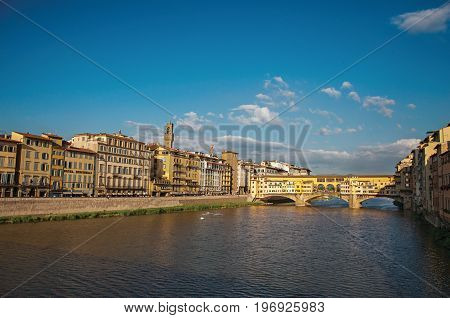 Florence, Italy - May 14, 2013. Overview of the river Arno, buildings and the Ponte Vecchio (bridge) at sunset. In the city of Florence, the famous and amazing capital of the Italian Renaissance. Located in the Tuscany region