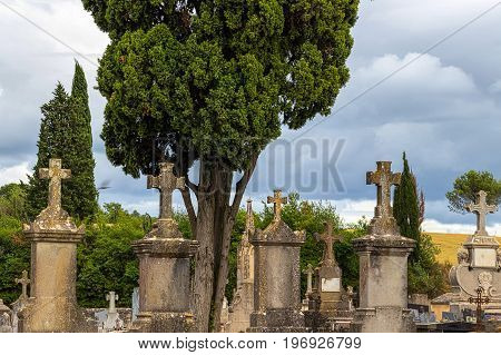 Old tombstones at antique european cemetery. Carcassonne, province Languedoc - Roussillon, France