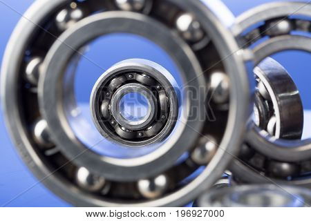 Group of various ball bearings close up on nice blue background