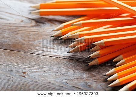 Yellow pencils on the brown wooden table