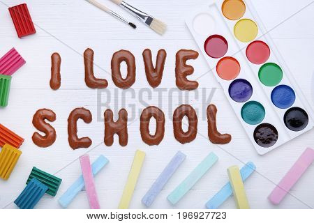 I Love School written by chocolate cookies alphabet with crayons and paints
