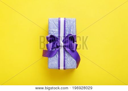 Gift Box With Ribbon On Yellow Background