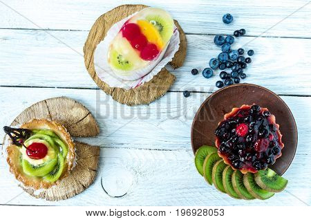 Three Sweet Pastries With Fresh Wild Berries.