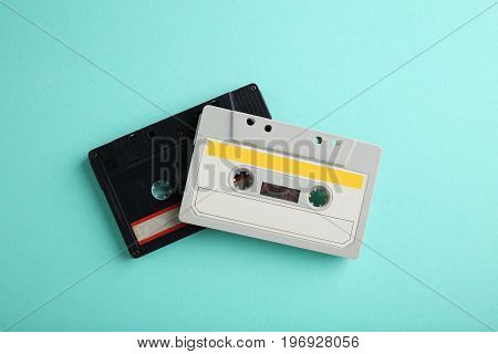 Old cassette tapes on the mint background