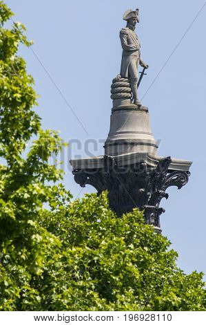 The statue of Vice Admiral Horatio Nelson on top of Nelsons Column viewed from The Mall in London UK.