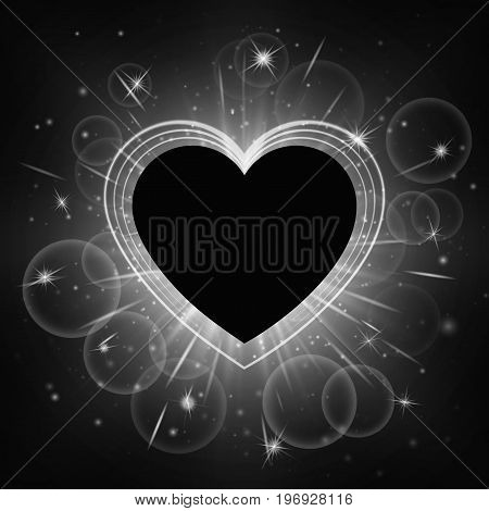 New year background with twinkle lights. Bright romantic wedding frame in the shape of a heart.
