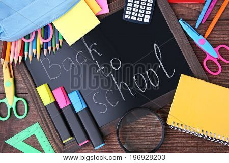 Inscription Back To School With Stationery On Wooden Table