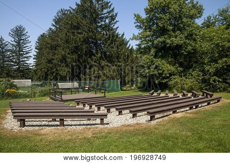 An outdoor stage and benches at the Watchung Reservation