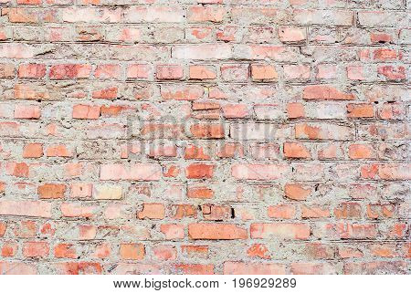 Old red brick wall for a background with a clear and rough texture