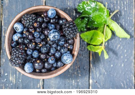 Forest Berries In A Clay Plate. Berries With Water Drops. Low Depth Of Field.