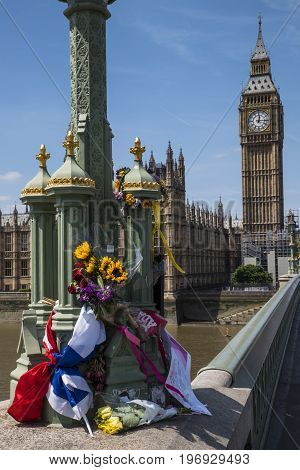 LONDON UK - JUNE 14TH 2017: Flowers and messages on Westminster Bridge in remembrance of the lives lost during the March 2017 Westminster terror attack in London taken on 14th June 2017.