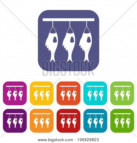 Three dried fish hanging on a rope icons set vector illustration in flat style in colors red, blue, green, and other