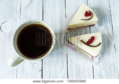 White Mug With Black Instant Coffee And White Cheesecakes. Flat Lay.