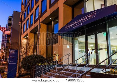 Washington Dc, Usa - March 4, 2017: George Washington University Sign And Entrance With Flag At Nigh