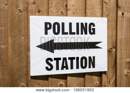 A sign pointing in the direction of a Polling Station on election day in the United Kingdom.
