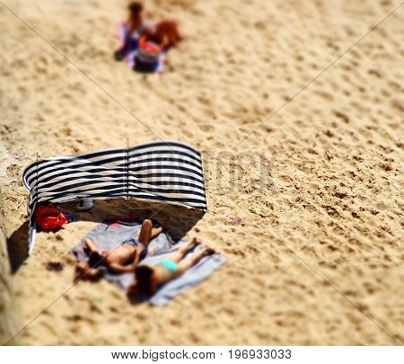 People Lying On The Beach, Tilt-shift Unfocused View