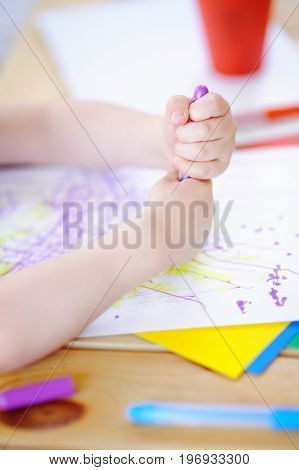 Cute Little Boy Drawing And Painting With Colorful Markers Pens At Kindergarten
