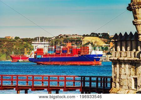 Cargo Ship Near The Belem Tower, Lisbon