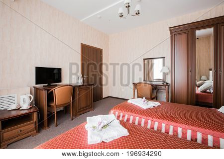 Hotel apartment, bedroom interior in the morning. standart room, with two bed