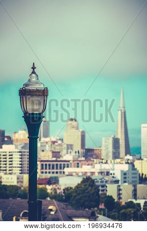 Retro Style Photo Of The San Francisco Skyline With Vintage Lamp In Foreground And Copy Space