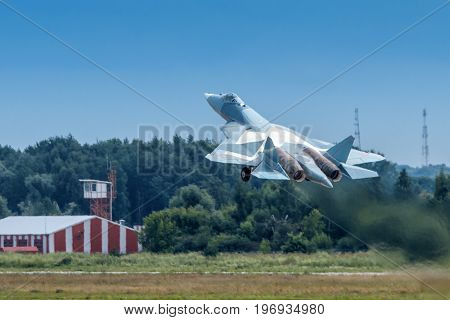 Moscow Region - July 21, 2017: New Russian fifth-generation fighter T-50 (Sukhoi PAK FA) takes off at the International Aviation and Space Salon (MAKS) in Zhukovsky.