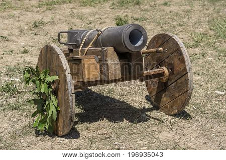 Medieval cannon Gunpowder artillery in the Middle Ages, on a reenactment. Medieval demonstration and recreation